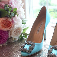 Teal shoes next to bridal bouquet