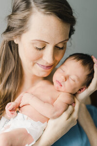 asheville newborn photography of a mom holding her baby