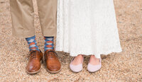 Bride and groom argyle socks  pink rothys wedding flats at their colonial Williamsburg virginia wedding