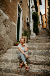 girl smiling on steps