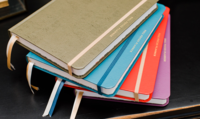 Stack of colorful Full Focus Planners