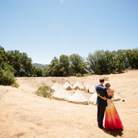 Bride & groom with tents in Sonoma