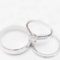 white gold wedding rings on white background