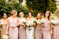 Bride and bridesmaids in mauve at lincoln park in chicago