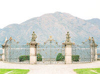 Villa Sola Cabiati front gate looking out over Lake Como. Photographed by Wedding Photographers in Charleston Amy Mulder Photography