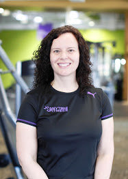 A client with a black Anytime Fitness shirt on smiling