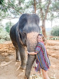 Monica Ann - travel photographer hugging an elephant