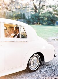 Bride and Groom Kiss in Rolls royce