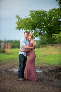Outdoor rustic farm maternity session