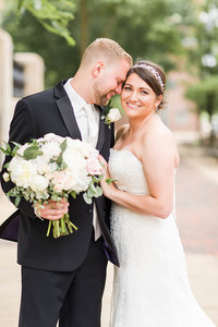 textured wedding bouquet with greens, whites, and purples at oaks lakeside wedding