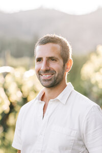 Portrait of groom in the vineyard during sunset engagement session at Beecher Hill House