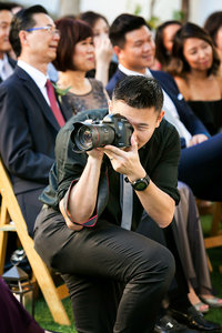 Client Henry in action photographing a wedding