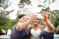 Bride photographed taking a selfie with her bridesmaids after the ceremony.