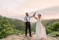 eloping couple dancing on an overlook in arkansas after
