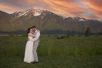 couple hugging overlooking a mountain