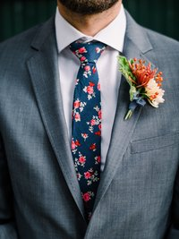 Groom wearing floral tie and boutonnière at Fremont Foundry Seattle