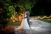 bride and groom pose for portrait at hidden acres wedding venue in marion, south carolina
