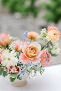 close up of a distant drum rose in a peach blue and lavender flower centerpiece at the cincinnati art museum designed by lexington wedding florist roots floral design