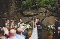 Bride and groom kissing during their wedding ceremony