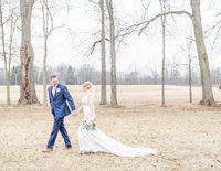 Bride and groom portraits in woods