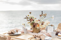 a decorated table top by the ocean