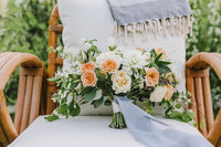 wedding bouquet sitting on chair