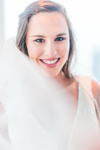 Bride smiles through long veil