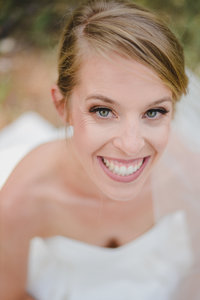 Happy bride portrait by Colorado wedding photographer