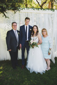 Bride groom and parent photo