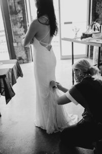 Wedding Planner helping bride