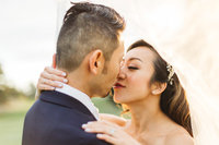 Bay area wedding photographer - couple  kissing under veil