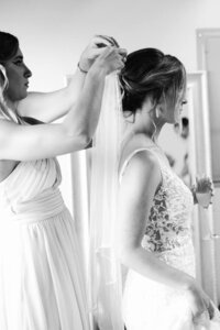 Maid of Honor getting bride ready to walk down the aisle.