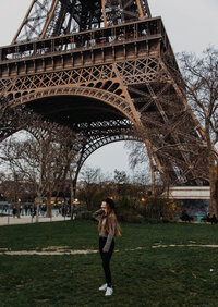 woman standing in front of the Eiffel tower