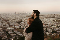 man and woman looking out over city