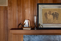 Redwood mantel, blue stone fireplace, and horse art