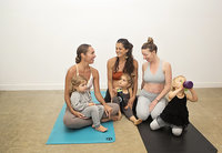 3 moms & their toddlers chat on yoga mats after yoga class at Hotsource Yoga in Aptos