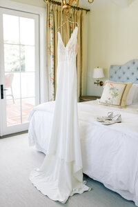 Wedding dress hanging in bridal suite at Harmony Meadows