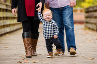 young kid holds mom's hand during mini sessions in Phoenixville