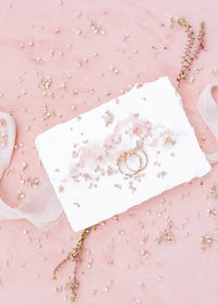 wedding details pink flatlay