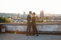 Gay males kissing on a roof top