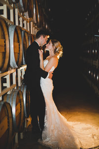 Bride and Groom hugging in the wine caves at Terra Blanca in Benton City