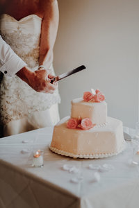 Cutting cake NYC wedding
