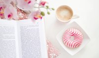 a-book-cup-of-coffee-and-flavoured-donut-on-square-white-696179