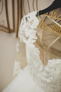 Hayley Paige wedding gown on hanger