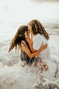 couple kissing in ocean