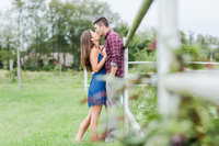 engagement photos on the family farm with bride and groom kissing in canton ohio