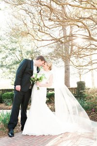 bride and groom standing close outdoors