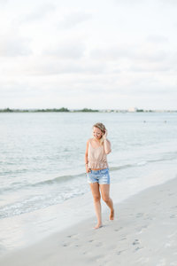 Charlotte Wedding Photographer | Heather Yvonne | Heather walking along beach shore