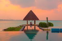 couple-under-hut-beside-sea-and-infinity-pool-1024967