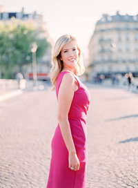 Cari looks over her shoulder in pink dress in Paris